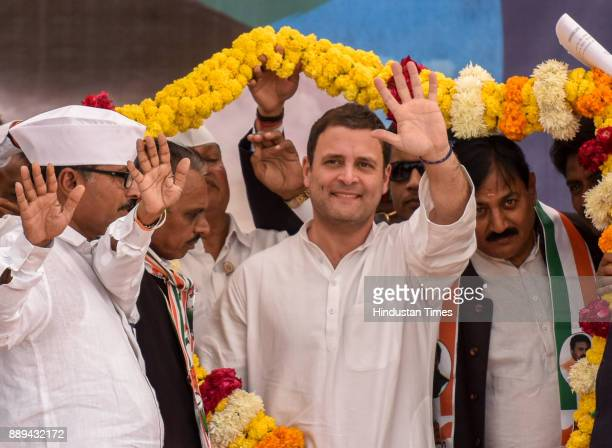 Congress Vice President Rahul Gandhi waves people during an election campaign rally for State Assembly Election at Patan on December 9 2017 in...