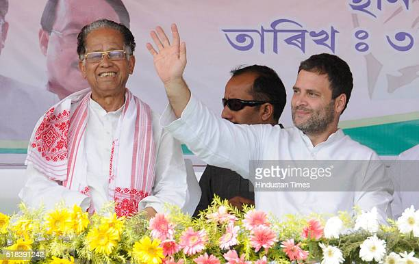 Congress Vice President Rahul Gandhi waving hand towards the crowd as Assam Chief Minister Tarun Gogoi looks during an election rally at Abhaipur...