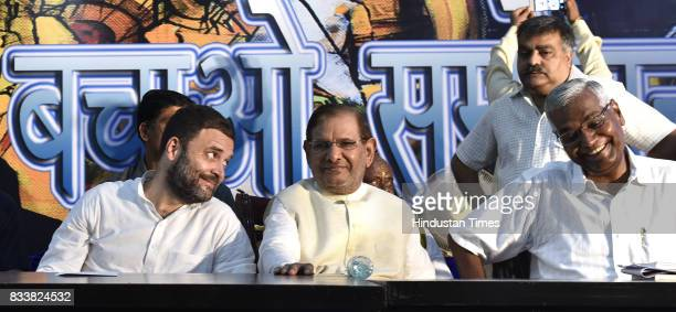 Congress Vice President Rahul Gandhi with Sharad Yadav and Left party leader D Raja during 'Sajhi Birasat Bachao Sammelan' called by JD leader Sharad...