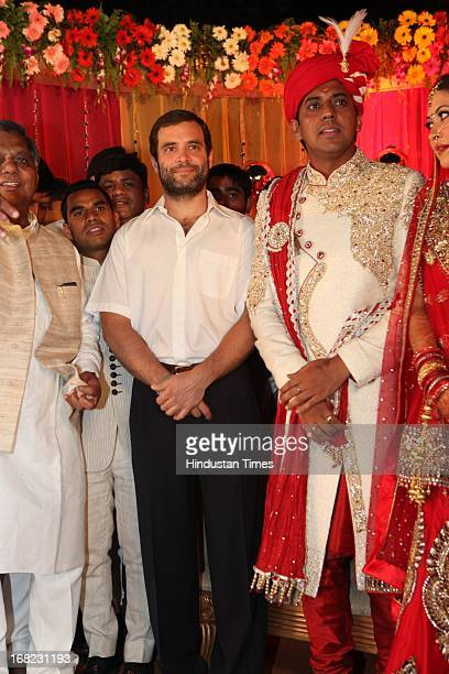 Congress VicePresident Rahul Gandhi pose with groom Ashok Basoya during his wedding ceremony with Ragini Nayak on May 5 2013 in New Delhi India
