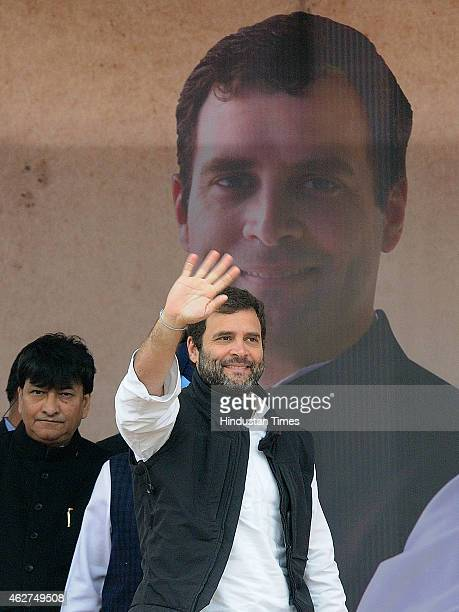 Congress VicePresident Rahul Gandhi waves to supporters during the election rally for the upcoming Delhi assembly elections at Bhalswa village...