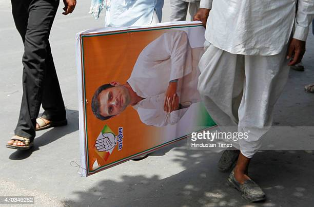 Congress worker carrying Congress VP Rahul Gandhi poster during the farmers rally of Congress President Sonia Gandhi to galvanise protests against...