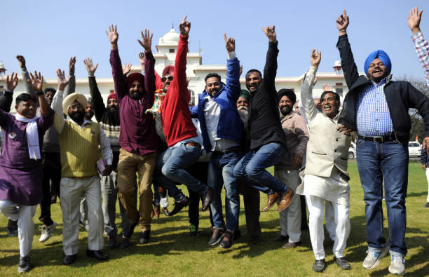 Congress workers and supporters celebrating after landslide victory in Punjab assembly elections on March 11 2017 in Amritsar India The Captain...