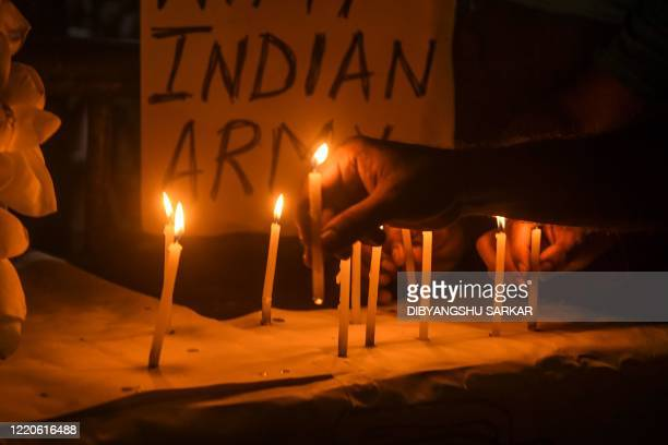 Congress workers and supporters light candles to pay tribute to the soldiers who lost their lives following a recent clash between India and China in...