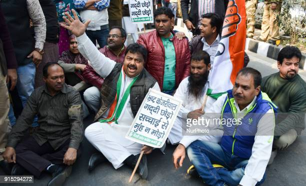Congress workers demonstrate to demand the resignation of Aam Aadmi Party Delhi Chief Minister Arvind Kejriwal on corruption charges in New Delhi on...