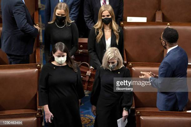 Congressional aides carry cases containing electoral votes during a joint session of Congress to count the Electoral College votes of the 2020...