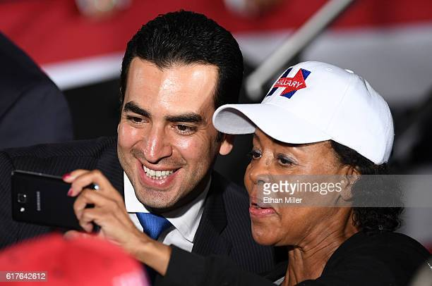 Congressional candidate and state Sen Ruben Kihuen takes a photo with a supporter after a campaign rally with US President Barack Obama for...