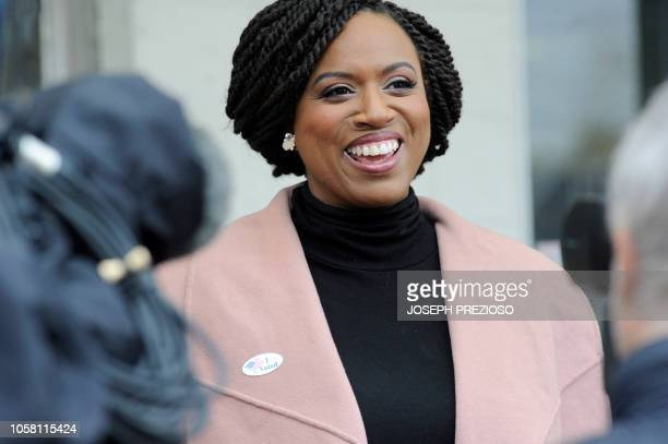 Congressional candidate Ayanna Pressley speaks to reporters after voting at the Adams Street Library on Election Day in Boston Massachusetts to vote...