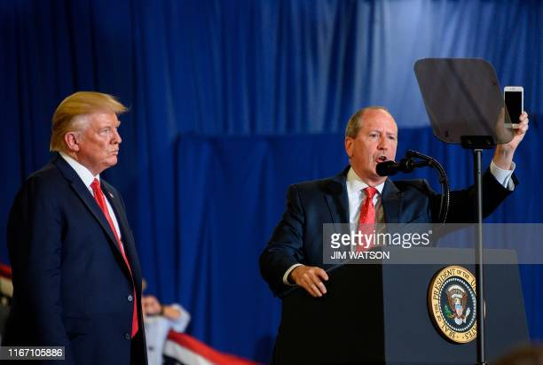 """Congressional candidate Dan Bishop speaks alongside US President Donald Trump during a """"Keep America Great"""" campaign rally at The Crown Arena in..."""