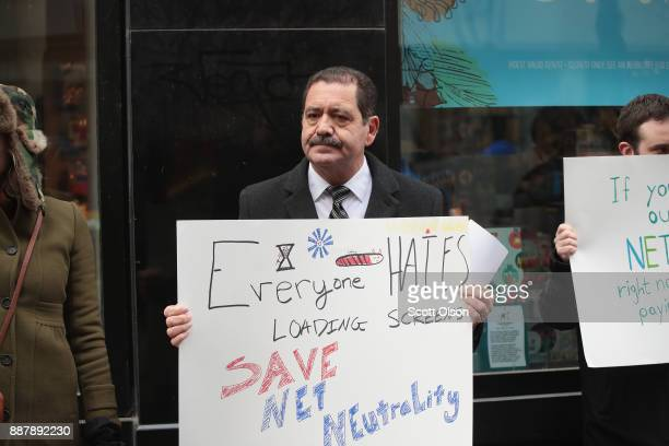 Congressional candidate Jesús 'Chuy' García joins demonstrators supporting net neutrality in a protest outside a Verizon store on December 7 2017 in...