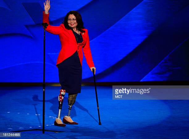 Congressional candidate Tammy Duckworth of Illinois waves as she leaves the stage after speaking at the 2012 Democratic National Convention at the...