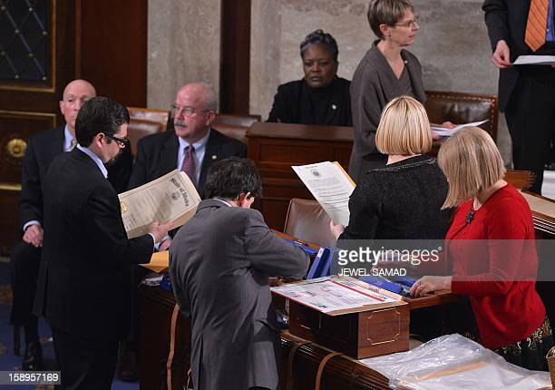 Congressional clerks help to count of the Electoral College votes for the 2012 presidential election during a joint Senate and House session at the...