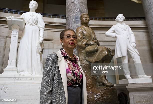 US Congressional Delegate Eleanor Holmes Norton of Washington DC speaks with students about Black History Month alongside a statue of Rosa Parks...