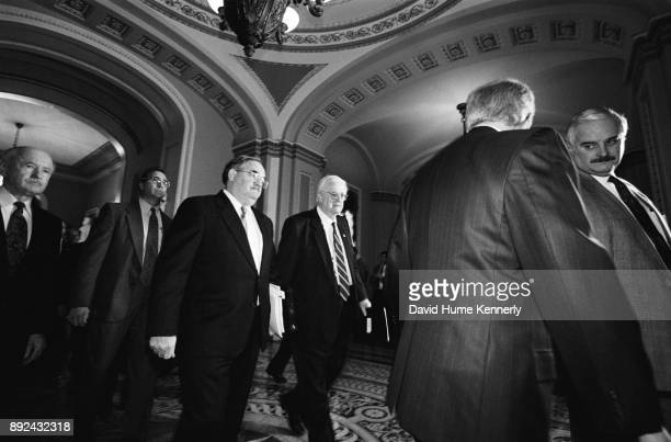 Congressional house managers including Henry Hyde chair of the House Judiciary Committee on the way to the Senate Chambers for the first day of the...