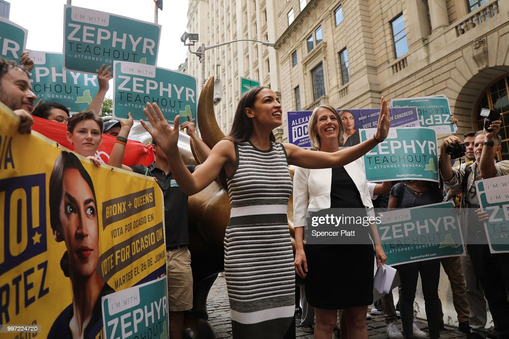 Congressional nominee Alexandria Ocasio-Cortez (L) stands with Zephyr Teachout after endorsing her for New York City Public Advocate on July 12, 2018 in New York City. The two liberal candidates held the news conference in front of the Wall Street bull in a show of standing up to corporate money. Ocasio-Cortez shocked the Democratic political community recently after an upset win against Representative Joe Crowley in the New York Democratic primary.