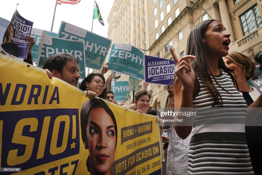 Congressional nominee Alexandria Ocasio-Cortez stands with Zephyr Teachout after endorsing her for New York City Public Advocate on July 12, 2018 in New York City. The two liberal candidates held the news conference in front of the Wall Street bull in a show of standing up to corporate money. Ocasio-Cortez shocked the Democratic political community recently after an upset win against Representative Joe Crowley in the New York Democratic primary.