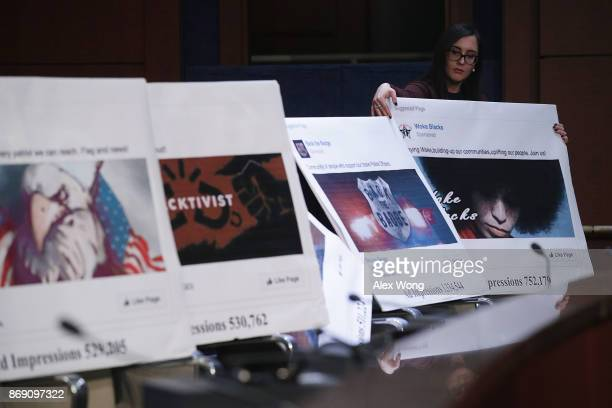 A congressional staff displays print out of social media posts during a hearing before the House Intelligence Committee November 1 2017 on Capitol...