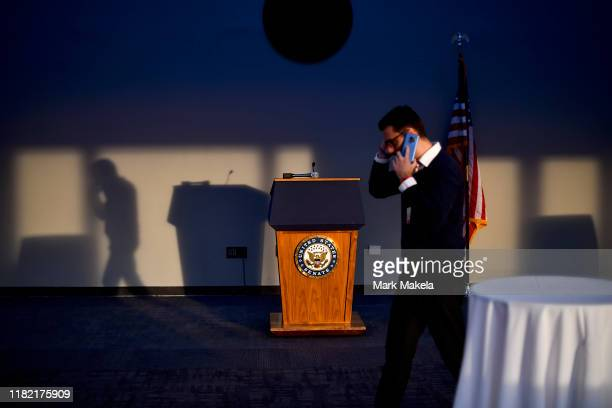 Congressional staff member speaks on the phone beside a lectern that states United States Senate on November 13 2019 in Washington DC In the first...