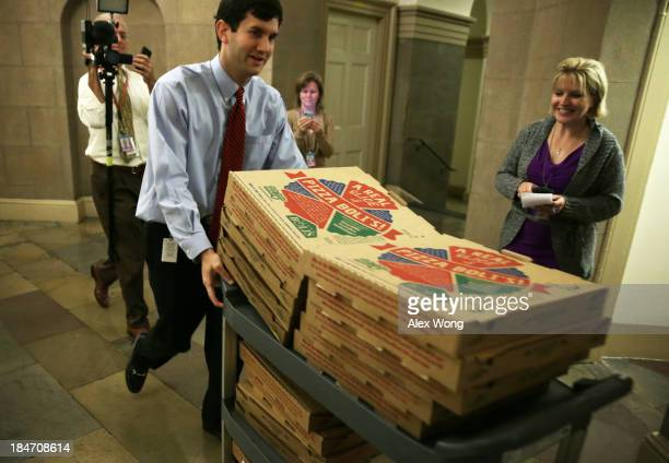 Congressional staffer brings in a cart full of pizzas at the US Capitol as both the Senate and House work on a deal to stop the government shutdown...