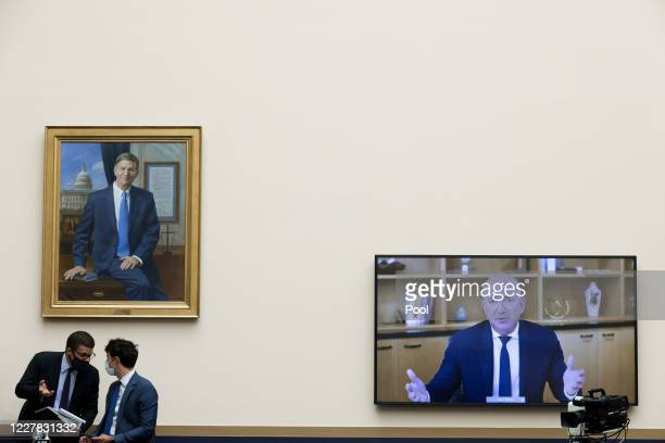 Congressional staffers confer as Amazon CEO Jeff Bezos testifies via video conference during the House Judiciary Subcommittee on Antitrust,...