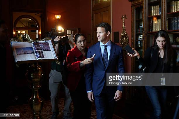 Congressman Aaron Schock speaks to the media as he arrives at an immigration reform panel hosted by the Illinois Business Immigration Coalition...