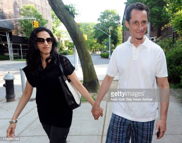 Congressman Anthony Weiner walking hand in hand with his wife Huma Abedin near their Forest Hills apartment