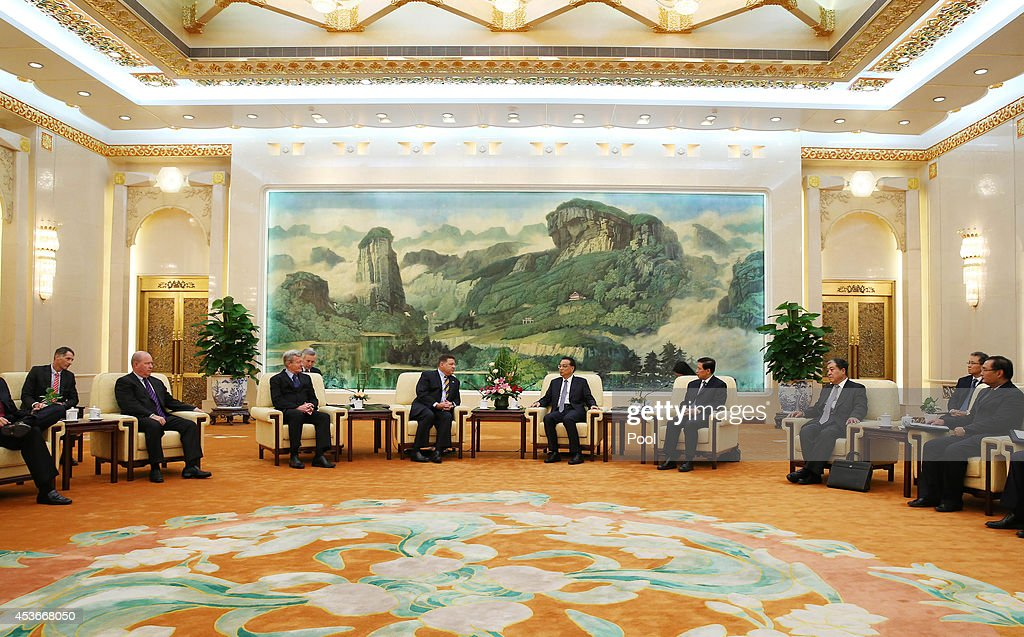 Congressman Bill Shuster (6-L), the U.S. Chair of the House Committee on Transportation and Infrastructure and fellow delegates meet with Chinese Premier Li Keqiang (5-R) at the Great Hall of the People on August 16, 2014 in Beijing, China.
