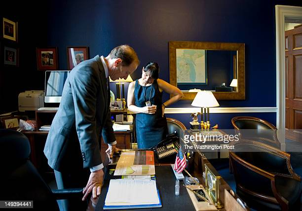 Congressman Dave Camp looks over material from the Michigan Farm Growers Association with Michelle Dimarob his Senior Advisor Public Relations and...