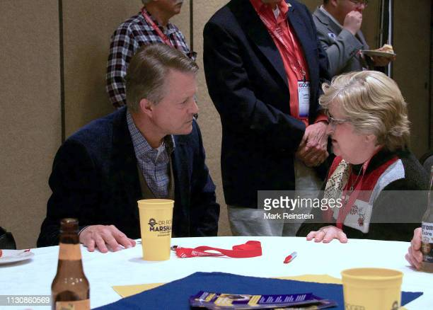 Congressman Doctor Roger Marshall talks with one of his constituents at the annual GOP convention in Topeka, Kansas, February 16, 2019.