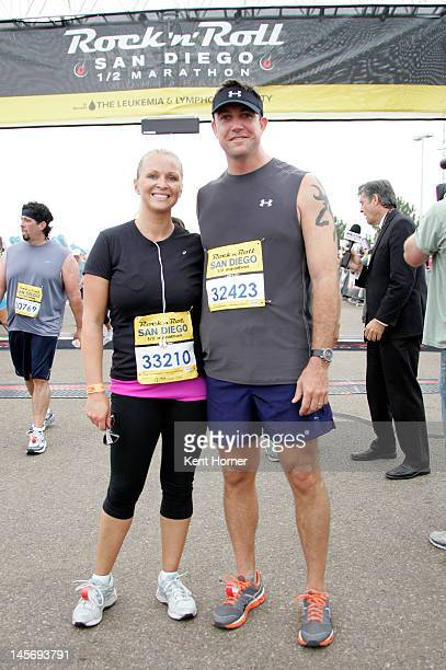 Congressman Duncan D Hunter poses with his wife Margaret at the finish line of the Rock 'n' Roll Marathon on June 3 2012 in San Diego California