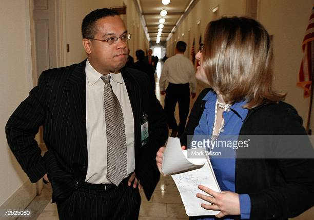 Congressman elect Keith Ellison who will also be the first Muslim in Congress talks with a reporter during a break in his orientation class on...