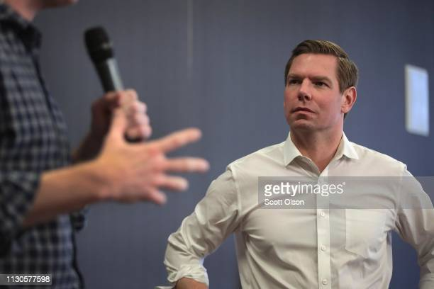 Congressman Eric Swalwell meets guests during an event at the Iowa City Public Library on February 18 2019 in Iowa City Iowa Swalwell has been making...