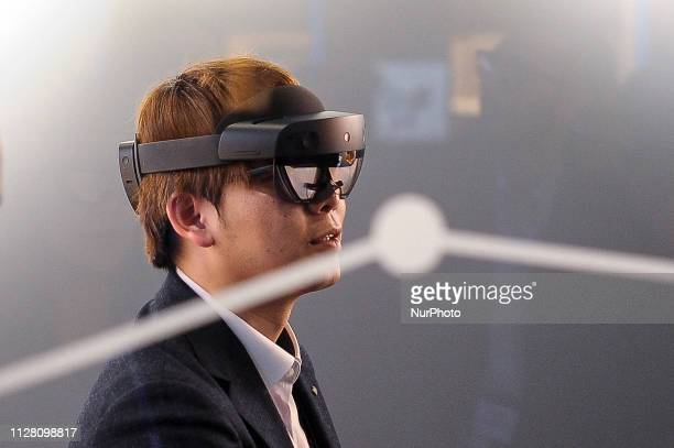 A congressman experience the augmented reality by HoloLens 2 a AR headset designed by Microsoft exhibited during the Mobile World Congress on...