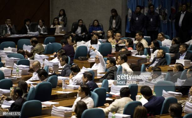 A congressman gives a thumbs down as he votes against the extension of Martial Law in MIndanao at the session hall of the House of Representatives in...