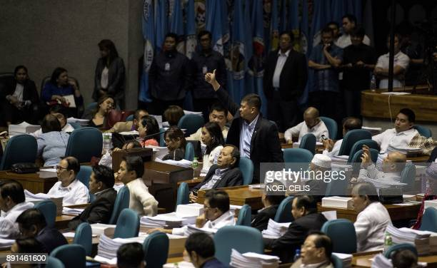 A congressman gives a thumbs up as he votes for the extension of Martial Law in MIndanao at the session hall of the House of Representatives in...