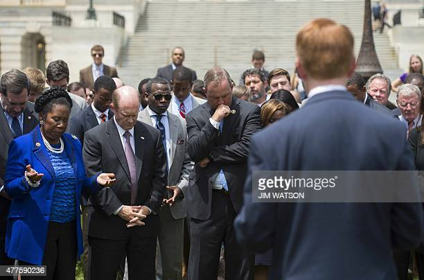 US Congressman Jeff Duncan RSouth Carolina prays with Senator Chris Coons DDeleware and Congresswoman Shelia Jackson Lee DTexas in front of the US...