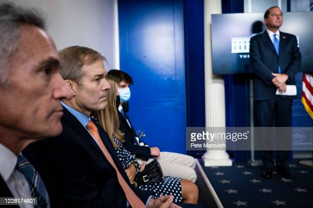 Congressman Jim Jordan and Health and Human Services Secretary, Alex Azar, wait for the arrival of President Donald Trump at a press conference in...