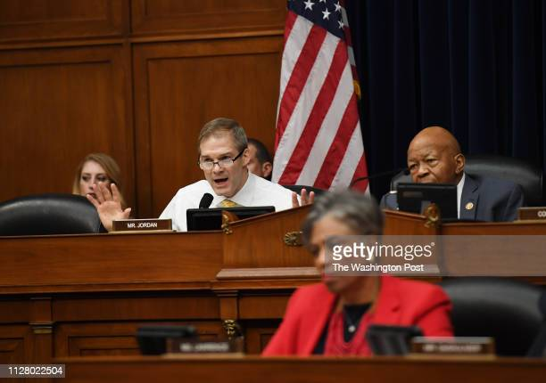 Congressman Jim Jordan left questions Michael Cohen former attorney to President Donald Trump testifies before the House Oversight Committee at the...