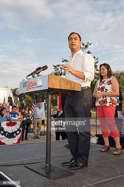 Congressman Joaquin Castro speaks as student Tiana Trejo attends the bus tour kickoff to support Leticia van de Putte for Lieutenant Governor on...