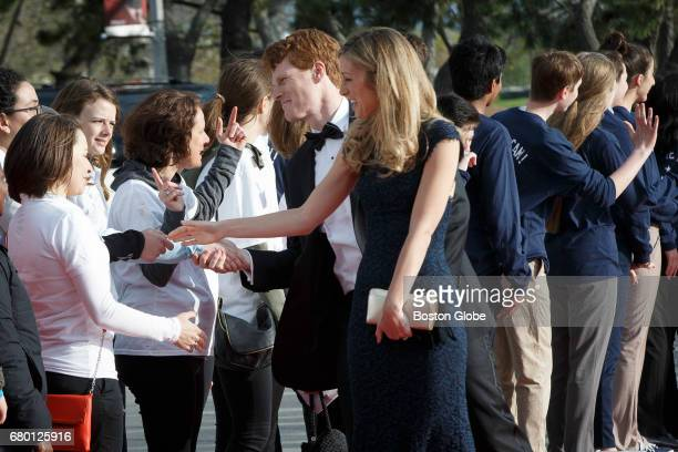 Congressman Joe Kennedy and his wife Lauren Anne Birchfield shake hands with greeters as they arrive for the annual John F Kennedy Profile in Courage...