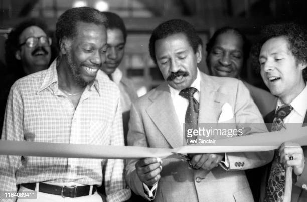 S Congressman John Conyers cutting the ribbon at the opening of the Detroit Jazz Center with politician Jack Faxon and author/historian Herb Boyd and...