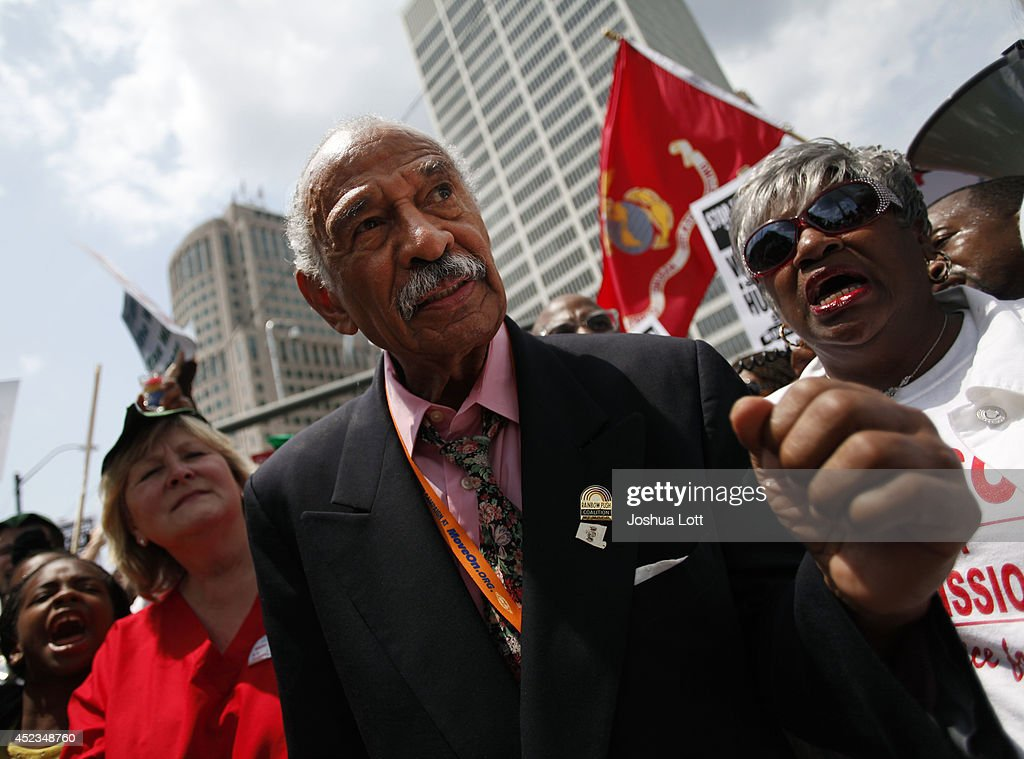 Congressman John Conyers, Jr., (D-Mich.) clinches his fist as he joins demonstrators protesting against the Detroit Water and Sewer Department July 18, 2014 in Detroit, Michigan. The Detroit Water and Sewer Department have disconnected water to thousands of Detroit residents who are delinquent with their bills.