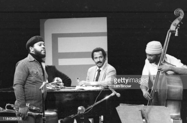 S Congressman John Conyers seated in middle with jazz trumpeter Marcus Belgrave and bassist Ali Muhammad Jackson Sr in Detroit Michigan in 1978