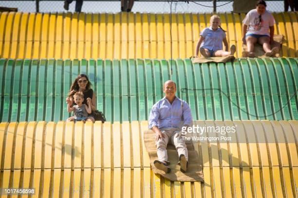 Congressman John Delaney takes a ride on the Giant Slide at the Iowa State Fair in Des Moines Iowa on Aug 10 2018