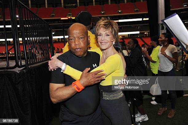 Congressman John Lewis and actress Jane Fonda attend the 2010 World Fitness Day at the Georgia Dome on May 1 2010 in Atlanta Georgia