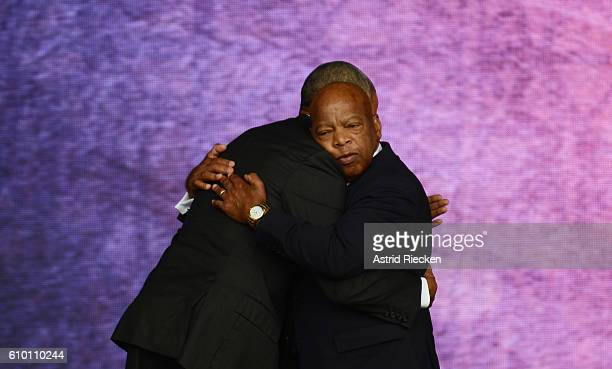 WASHINGTON DC SEPTEMBER 24 Congressman John Lewis is embraced by US President Barack Obama after his speech during the dedication of the National...