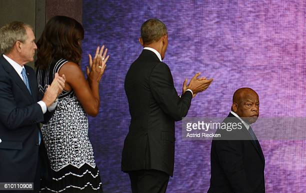 Congressman John Lewis receives applause from US President Barack Obama former President George Bush and First Lady Michelle Obama while approaching...