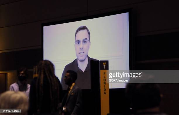 Congressman Justin Amash of Michigan addresses delegates by video during the 2020 Libertarian National Convention at the Orange County Convention...