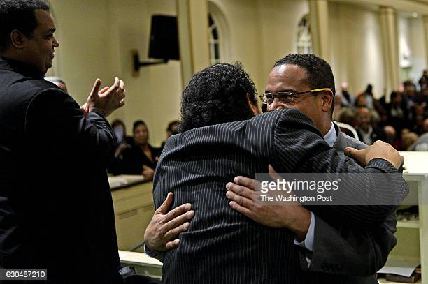 Congressman Keith Ellison right hugs his brother and Church of the New Covenant Baptist pastor Brian Ellison before speaking in Detroit United States...