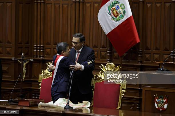 Congressman Luis Galarreta left greets Martin Vizcarra Peru's president center during a swearing in ceremony in Lima Peru on Friday March 23 2018...